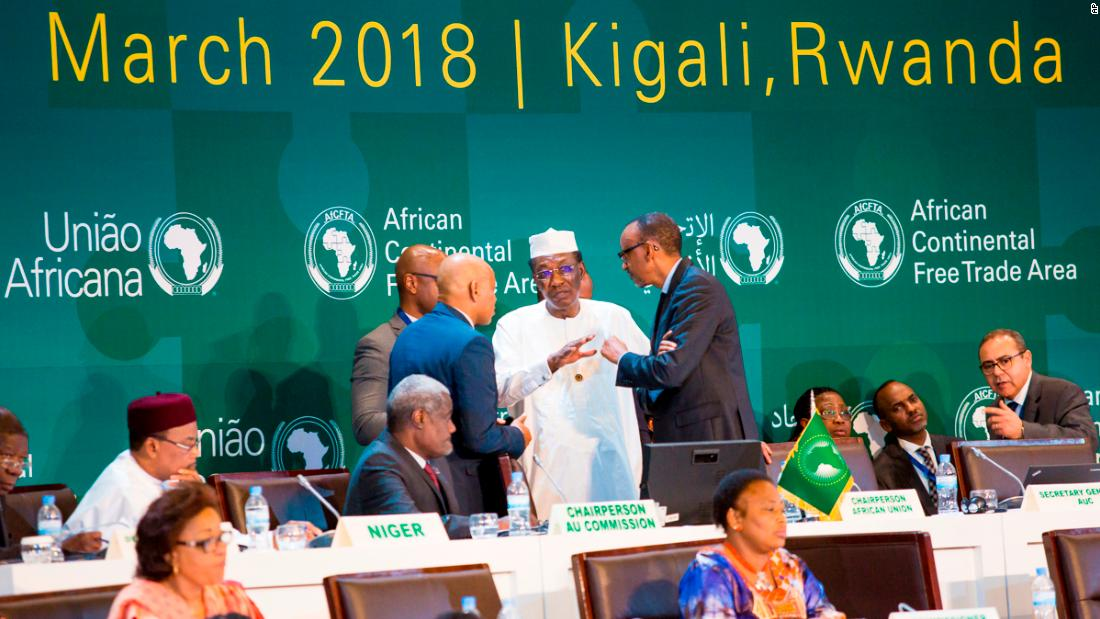 "Rwandan President Paul Kagame, left, consults with Chadian President Idriss Deby, middle, on Wednesday, March 21, before <a href=""https://www.cnn.com/2018/03/22/africa/african-trade-agreement-world/index.html"" target=""_blank"">signing the African Continental Free Trade Area Agreement</a> in Kigali, Rwanda. It is being called the largest free trade agreement since the creation of the World Trade Organization."