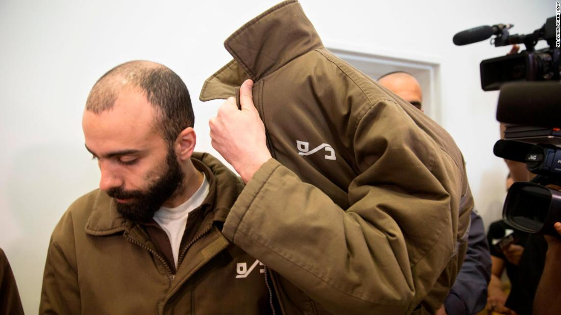 "Romain Franck, a worker at the French Consulate in Jerusalem, covers his face during a hearing at the district court in in the southern Israeli city of Beersheba on Monday, March 19. Franck, 24, has been <a href=""https://www.cnn.com/2018/03/19/middleeast/french-consulate-israel-gaza-weapons-intl/index.html"" target=""_blank"">arrested for smuggling weapons</a> from Gaza into East Jerusalem and the West Bank using his diplomatic immunity, the Israel Security Agency announced Monday after a joint investigation with Israeli police."