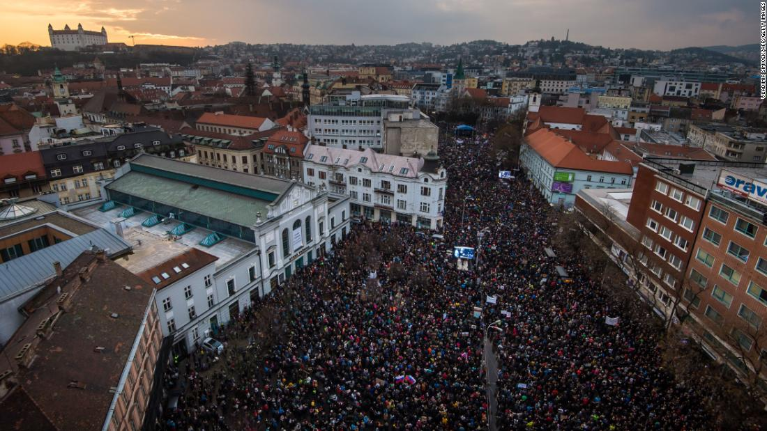 "People gather at the Slovak National Uprising square in Bratislava, Slovakia, on Friday, March 16, <a href=""https://www.cnn.com/2018/03/16/europe/slovakia-protests-journalist-murder-intl/index.html"" target=""_blank"">to rally against corruption and to pay tribute</a> to murdered Slovak journalist Jan Kuciak and his fiancée Martina Kusnirova."