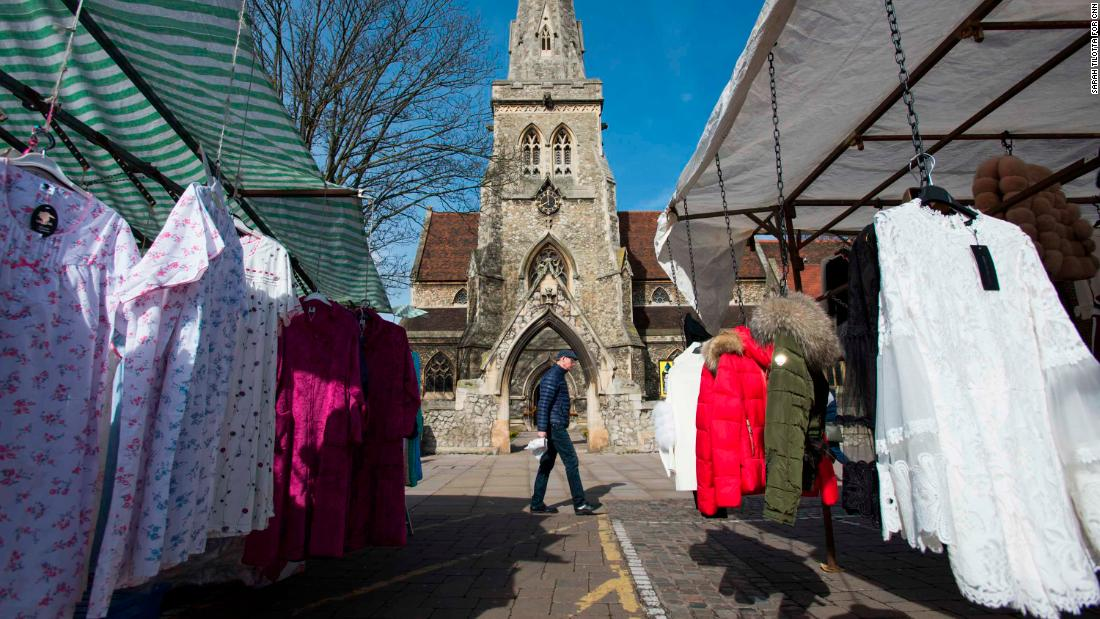 A man passes by market stalls in Romford.