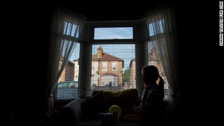 Leatherbarrow's older daughter, 6-year-old Gwen, is silhouetted against their front window.