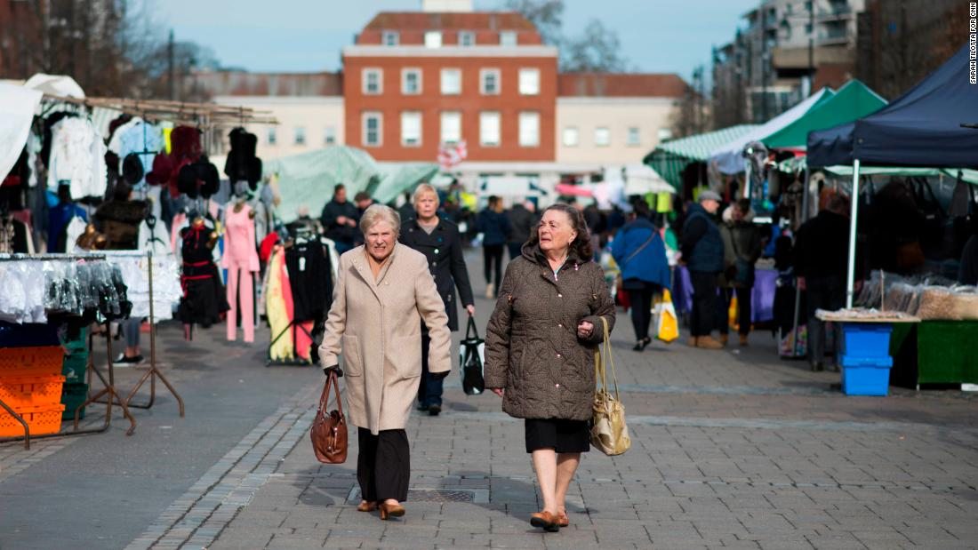 People stroll through Romford Market on Wednesday, March 14.