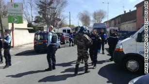 Police respond to the hostage situation Friday in the southern French town of Trèbes.