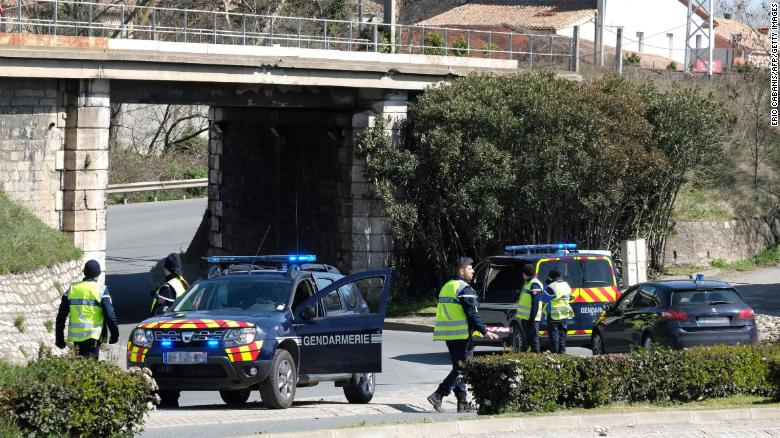 French police block access to Trèbes as they respond to the hostage situation Friday.