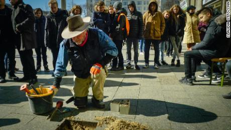 "Gunter Demnig, the artist behind the ""stumbling stones,"" installs brass plaques for individuals killed in the Holocaust."