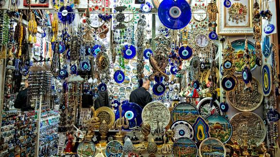Charms used to ward off the evil eye hang in a shop at the Grand Bazaar in Istanbul.