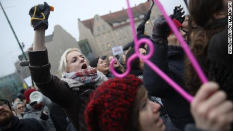 Protesters march against planned restrictions on abortions in Poland.