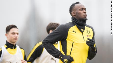 Usain Bolt warms up during a training of Borussia Dortmund on March 23, 2018 in Dortmund, Germany
