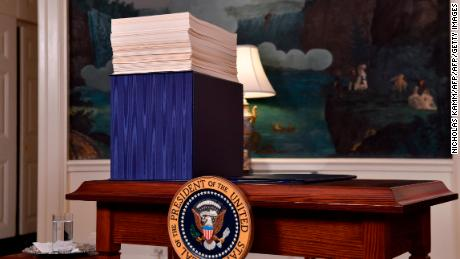 A copy of the spending bill, approved by Congress, is seen on a desk before US President Donald Trump speaks about the bill in the Diplomatic Room at the White House on March 23, 2018.  / AFP PHOTO / Nicholas Kamm        (Photo credit should read NICHOLAS KAMM/AFP/Getty Images)