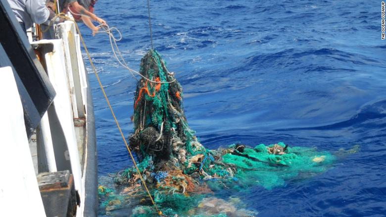 Researchers pull up a discarded fishing net from the Pacific Ocean.