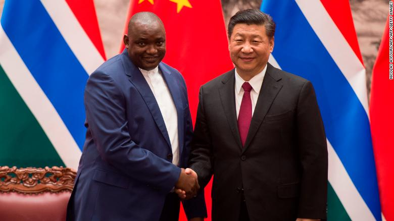 Gambia's President Adama Barrow with China's President Xi Jinping at the end of a signing ceremony at the Great Hall of the People in Beijing on December 21, 2017.
