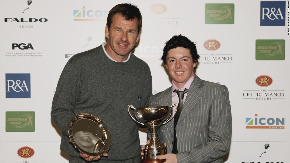 <strong>Standout junior:</strong> The young Northern Irishman was a child prodigy. He won the World U10 title and here poses with six-time major champion Nick Faldo after winning the Under 17 Division of the 2006 Faldo Junior Series at Celtic Manor in Wales.
