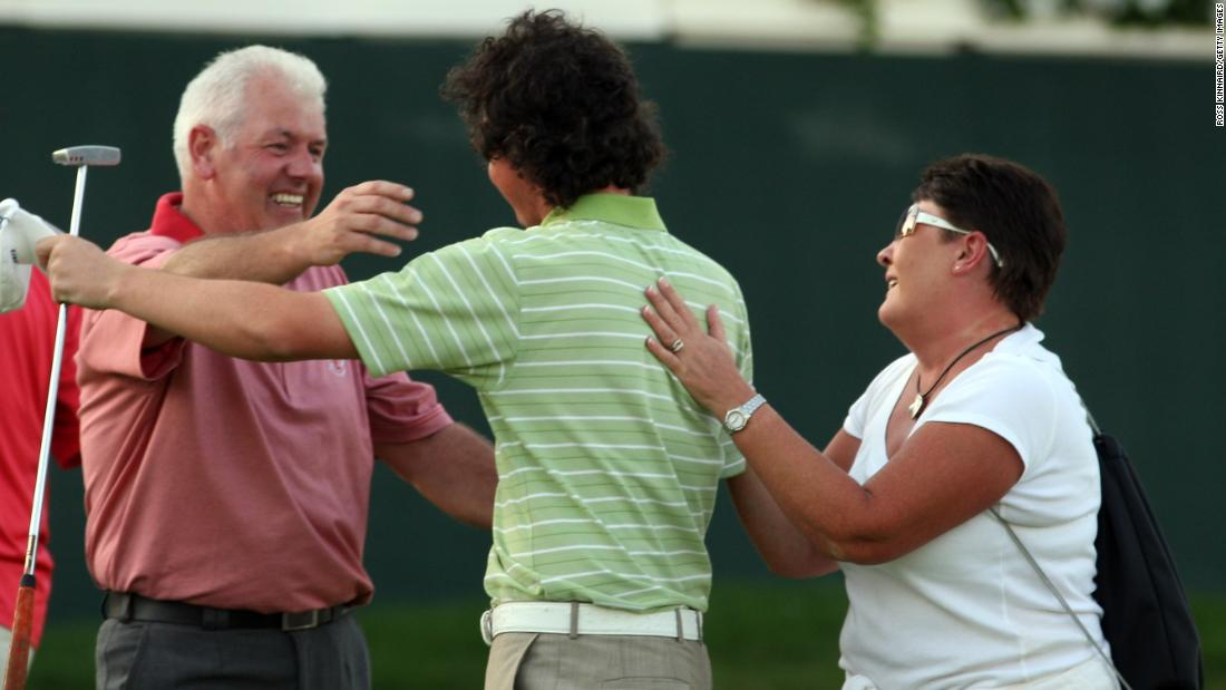 <strong>Family affair:</strong> McIlroy's delighted parents Gerry and Rosie had worked multiple jobs and poured every penny into his obsession with golf from a young age.