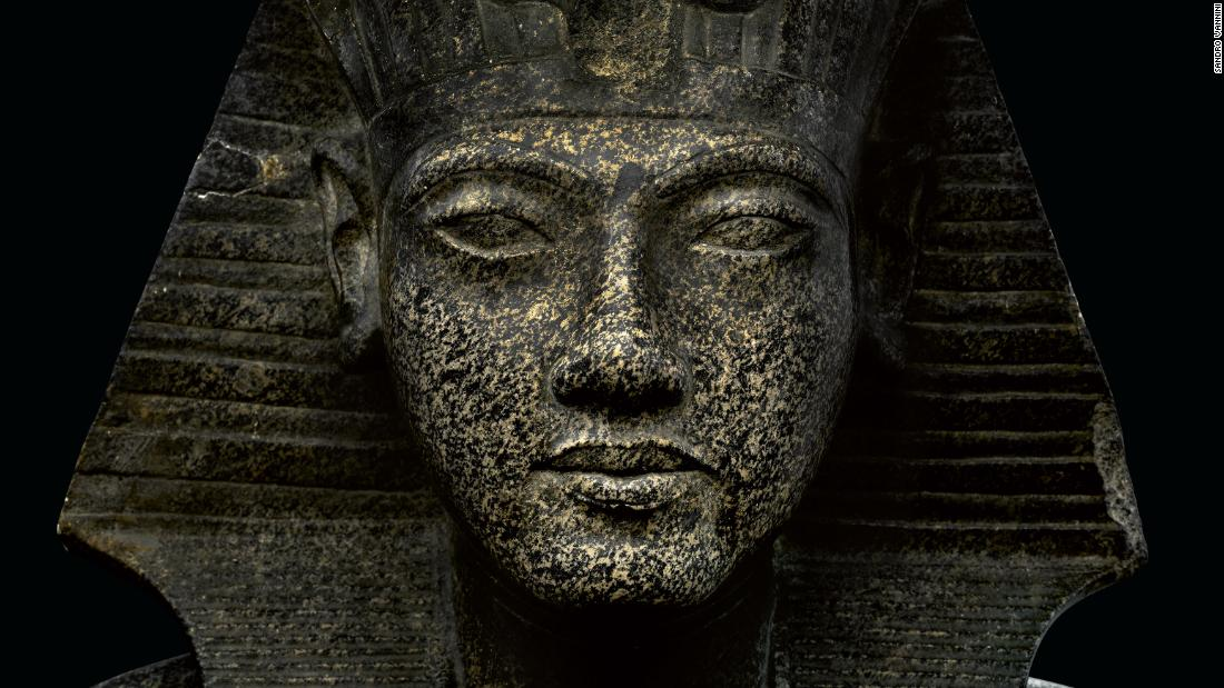 This photograph captures a statue depicting the young king in the nemes headdress.