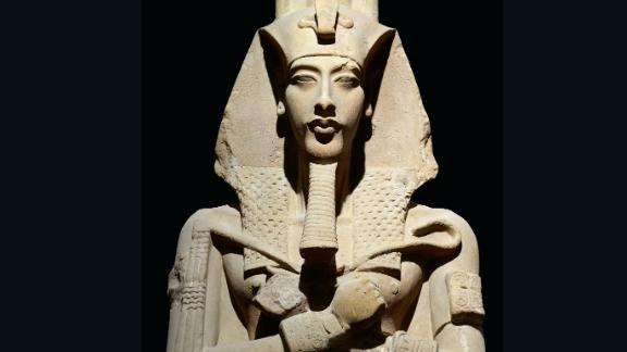 This statue, one of the colossal statues that originally stood in front of the pillared hall of the Temple of the Aten at Karnak, presents the king wearing the royal nemes-headdress with a uraeus at the forehead.