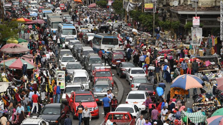Egyptian drivers stuck in congestion this month by the El Ataba open-air market in Cairo.