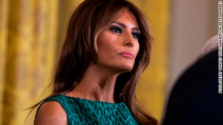WASHINGTON, DC - MARCH 15: First lady Melania Trump looks on as United States President Donald J. Trump speaks during the Shamrock Bowl Presentation at the White House on March 15, 2018 in Washington, D.C.   (Photo by Alex Edelman-Pool/Getty Images)