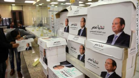 Members of Egyptian President Abdel Fattah al-Sisi's presidential campaign staff stand next to boxes containing signatures in his support, needed to register for the elections, at the National Election Authority, in Cairo on January 24, 2018. Egyptian leader Abdel Fattah al-Sisi formally submitted his candidacy for presidential elections in March that he looks certain to dominate as a string of potential challengers have dropped out.   / AFP PHOTO / MOHAMED EL-SHAHED        (Photo credit should read MOHAMED EL-SHAHED/AFP/Getty Images)
