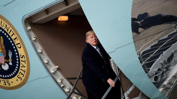US President Donald Trump boards Air Force One upon arrival at Andrews Air Force Base in Maryland before heading to Mar-a-Lago in West Palm Beach, Florida, for the weekend on March 23, 2018.  / AFP PHOTO / Brendan Smialowski        (Photo credit should read BRENDAN SMIALOWSKI/AFP/Getty Images)