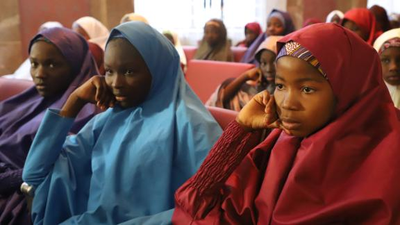 Some of the Dapchi schoolgirls released by Boko Haram sit before their meeting with the Nigerian President on Friday.