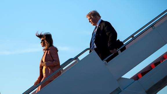 Barron Trump (L), US first lady Melania Trump (C) and US President Donald Trump arrive at Palm Beach International Airport March 23, 2018 in West Palm Beach, Florida before heading to Mar-a-Lago for the weekend on March 23, 2018.  / AFP PHOTO / Brendan Smialowski        (Photo credit should read BRENDAN SMIALOWSKI/AFP/Getty Images)