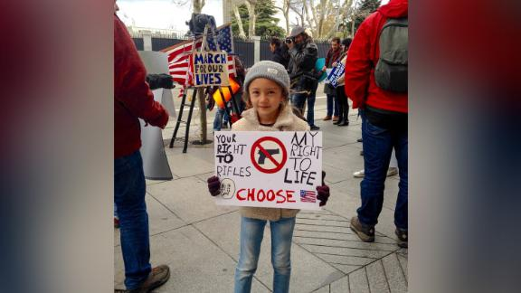 Lucia Smith, 6, gets an early introduction to activism by marching Saturday in Madrid.