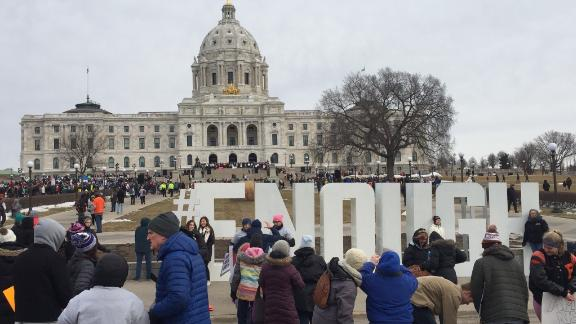 "Jennifer Skiba took this photo of marchers and a large ""#ENOUGH"" sign Saturday in front of the capitol in St. Paul, Minnesota, on Saturday, March 24, 2018."