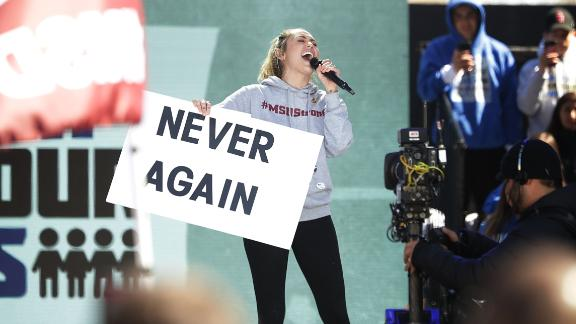 "Miley Cyrus performs ""The Climb"" during the March for Our Lives rally on March 24, 2018 in Washington."