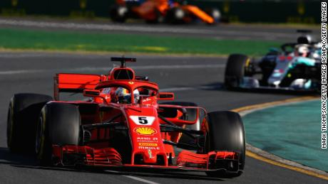 Sebastian Vettel of Germany leads Lewis Hamilton on his way to victory in the 2018 Australian Grand Prix in Melbourne.
