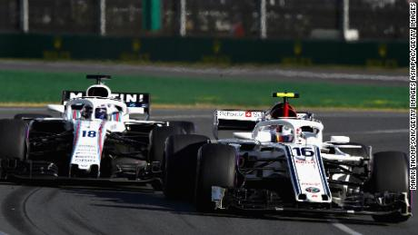 Leclerc battles to stay ahead of Lance Stroll of Williams during his Formula 1 debut in the season-opener at the Australian Grand Prix.