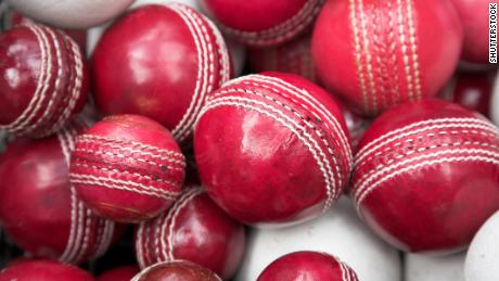 old, red cricket balls