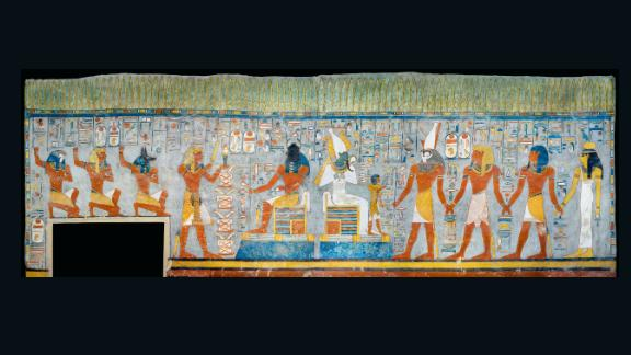 The tomb of Ramesses: Kephri and Osiris sitting on their throne.