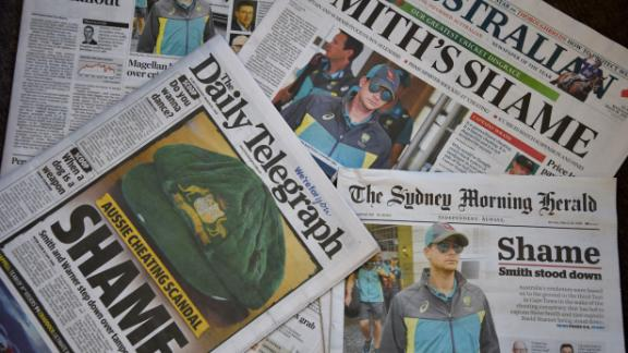 TOPSHOT - Photo shows Australian cricket captain Steve Smith on the front pages of the major newspapers in Sydney on March 26, 2018.    Australia