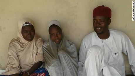 One of the freed Dapchigirls Aisha Kachalla,  with her father, Kachalla Bukar and mother, Serohvana.
