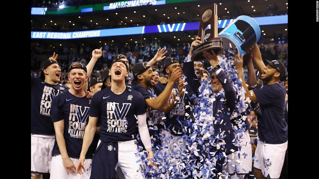 Villanova players dump confetti on head coach Jay Wright after the Wildcats defeated Texas Tech 71-59 on Sunday, March 25. Villanova will face Kansas in the Final Four this weekend.