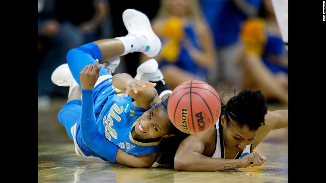 UCLA's Jordin Canada, left, and Mississippi State's Morgan William dive for a loose ball during an NCAA Tournament game on Sunday, March 25. Mississippi State won 89-73 to advance to the Final Four.