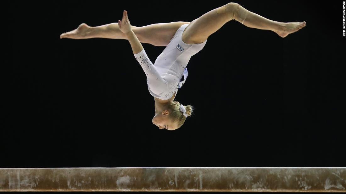 Russian gymnast Angelina Melnikova competes on the balance beam during a World Cup event in Birmingham, England, on Thursday, March 22.