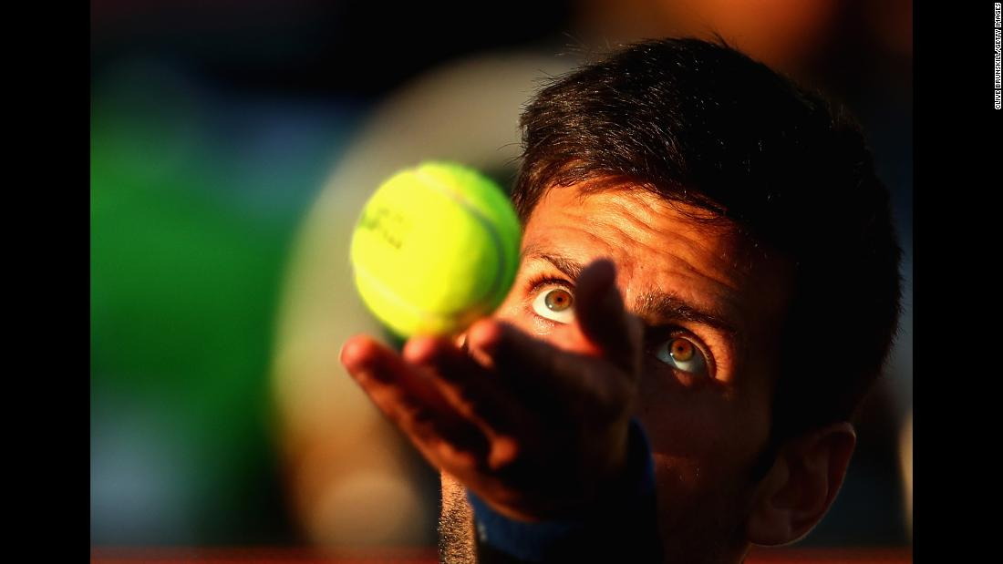 Novak Djokovic serves during a doubles match at the Miami Open on Thursday, March 22.