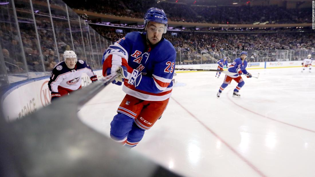 Ryan Sproul, a defenseman for the New York Rangers, reaches for the puck during an NHL game against Columbus on Tuesday, March 20.