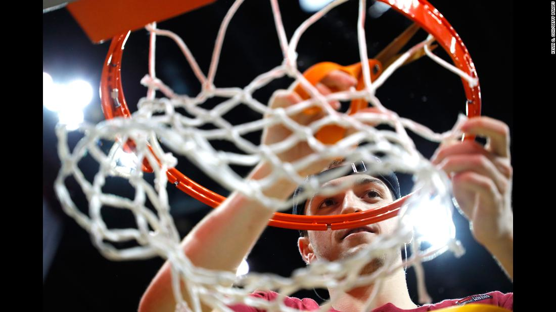 Loyola guard Clayton Custer cuts down the net on Saturday, March 24, after the Chicago university -- a No. 11 seed -- defeated Kansas State to clinch an unlikely spot in the Final Four.