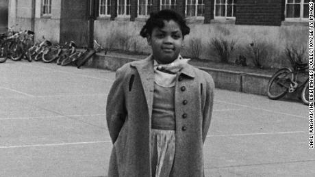Linda Brown, 9-yr-old black girl refused admission to white elementary school in front of segregated Monroe Elementary School which she attends.  (Photo by Carl Iwasaki/The LIFE Images Collection/Getty Images)
