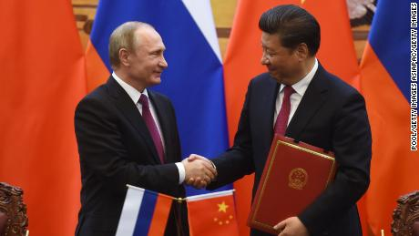 Putin shakes hands with Chinese President Xi Jinping during a signing ceremony in Beijing's Great Hall of the People in 2016.