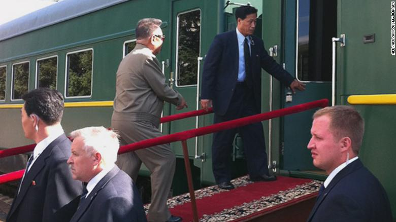 North Korean leader Kim Jong-Il enters his armoured carriage at a station in Novobureisky, Russian on August 21, 2011.