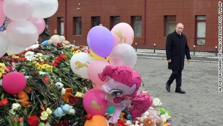Russian President Vladimir Putin visits a memorial for the victims of the fire on Tuesday