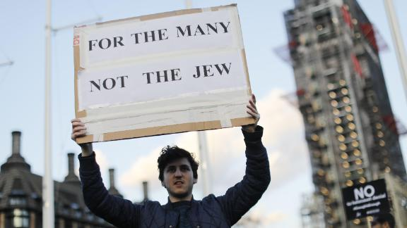 Members of the Jewish community hold a protest against Britain's opposition Labour party leader Jeremy Corbyn and anti-semitism in the  Labour party, outside the British Houses of Parliament.