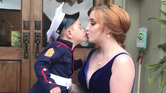 toddler fills in as prom date for marine brother orig_00003609.jpg