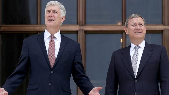 WASHINGTON, DC - JUNE 15:  Supreme Court Justice Neil Gorsuch (L) talks with Chief Justice John Roberts (R) on the steps of the Supreme Court following his official investiture at the Supreme Court June 15, 2017 in Washington, DC. Gorsuch has been an active member of the court since his confirmation though the official investiture ceremony was held today.  (Photo by Win McNamee/Getty Images)
