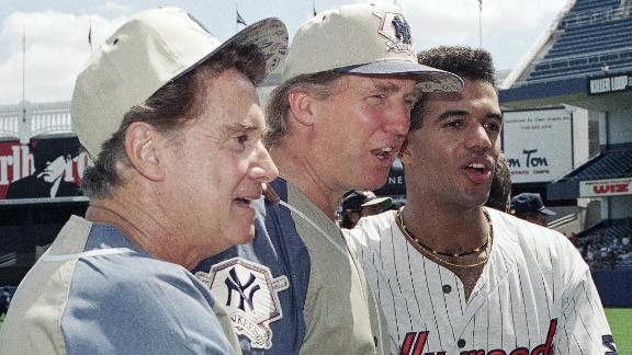 Television talk show host Regis Philbin, left, Donald Trump, center, and daytime television actor Kristoff St. John, pose for photographers before the third annual celebrity softball game at Yankee Stadium in New York on July 31, 1993.