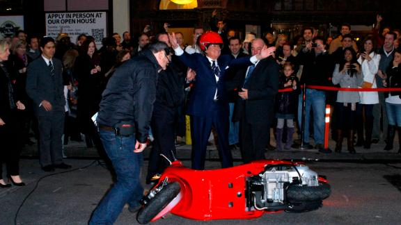 """Regis Philbin crashes his scooter during the """"Late Show With David Letterman"""" at the Ed Sullivan Theater in New York City on November 17, 2011."""