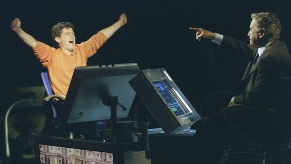 """Bernie Cullen, left, on ABC's """"Who Wants To Be a Millionaire,"""" the popular game show hosted by Regis Philbin."""